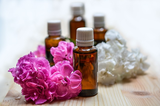 image of natural essential oil bottles and flowers