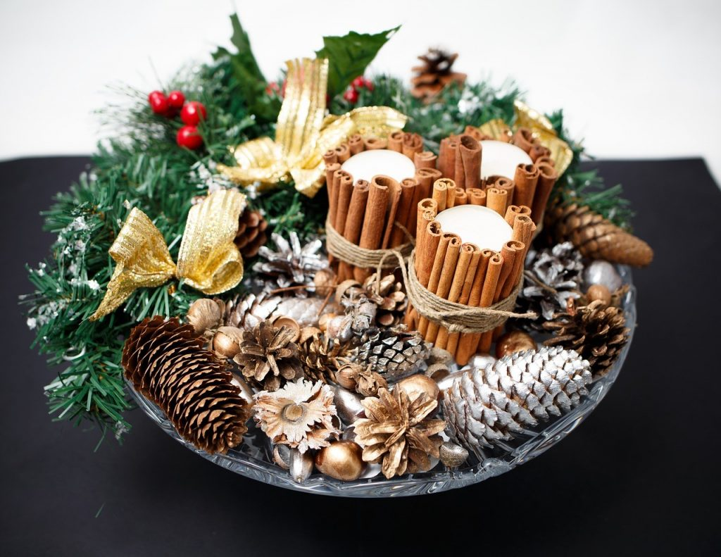 image of a tray filled with delicious smelling pine-cones, cinnamon sticks and holiday greens