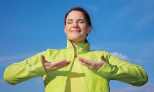 image of smiling woman breathing fresh air