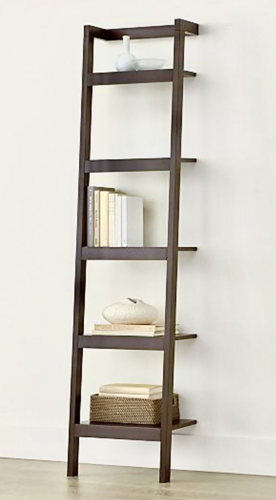 image of free standing book rack furniture with decorating items placed on it