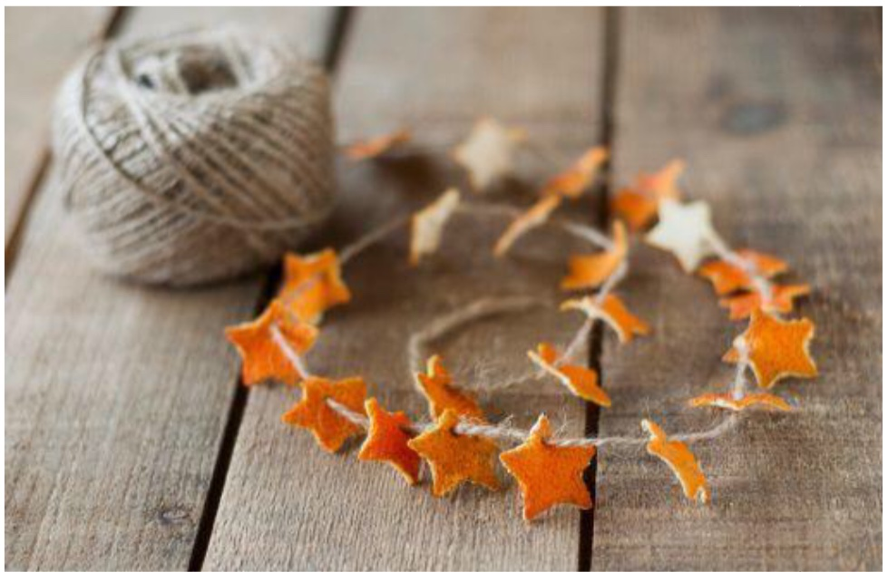 image of Holistic Home Decorations stars created from orange peels strung on a natural fiber string