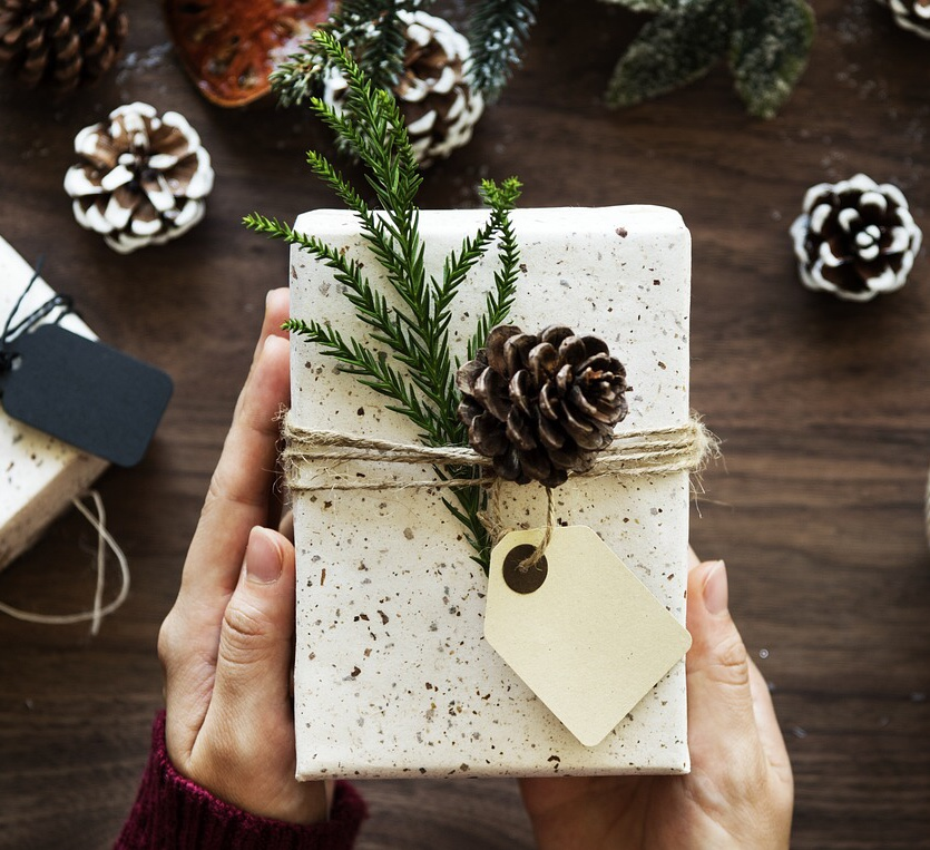 image of a Holistic Home Decorations gift wrapped box using an evergreen sprig and pine-cone instead of a bow