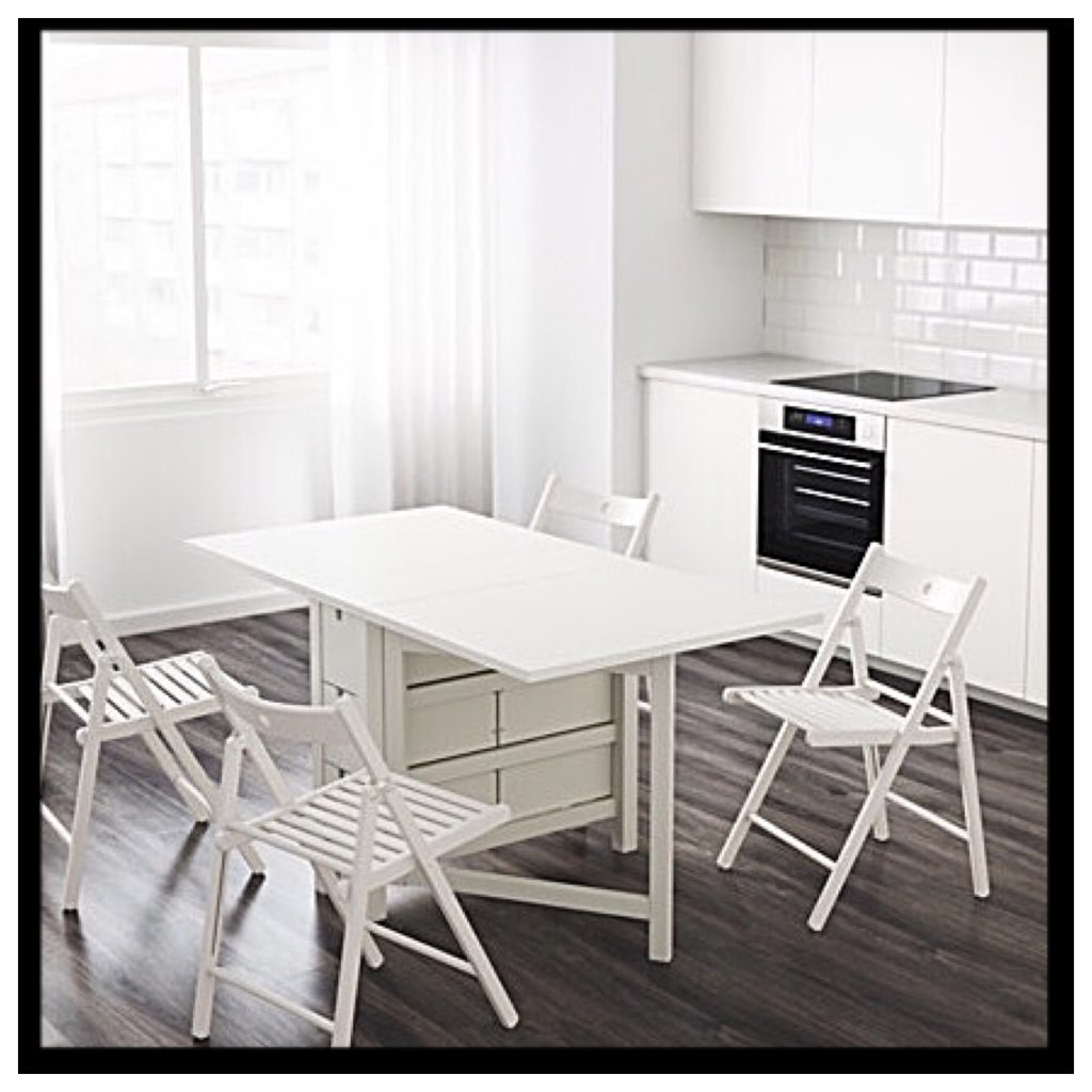 image of a white kitchen table that expands with drawers and storage space