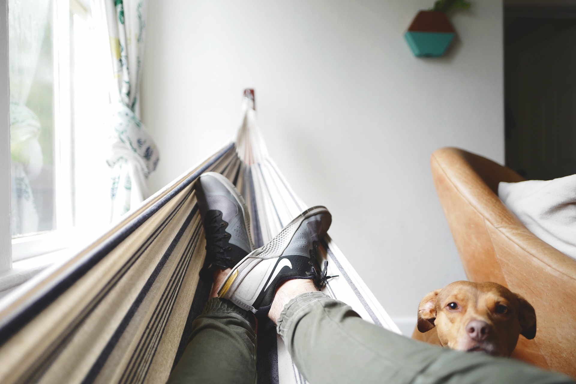 image of person relaxing on an indoor hammock to replicate outdoor living spaces
