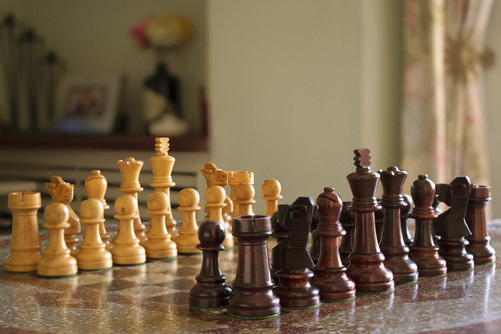 image of beautiful natural wood chess set