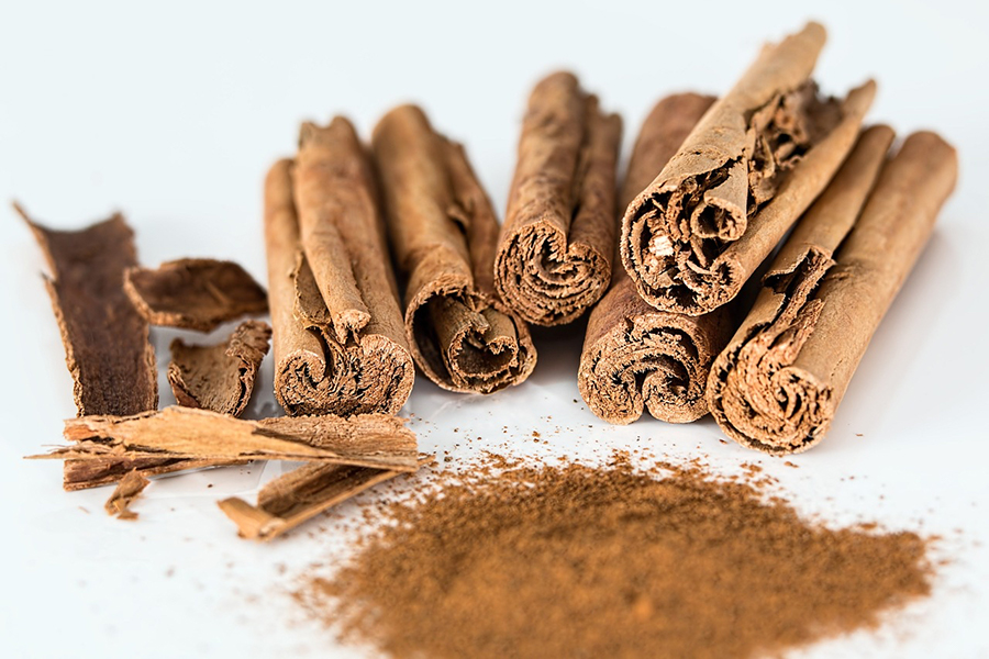 Image of cinnamon sticks and powder. One source of essential oil.