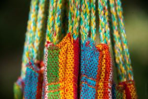 image of a portion of a colorful hammock foer your small livingspace