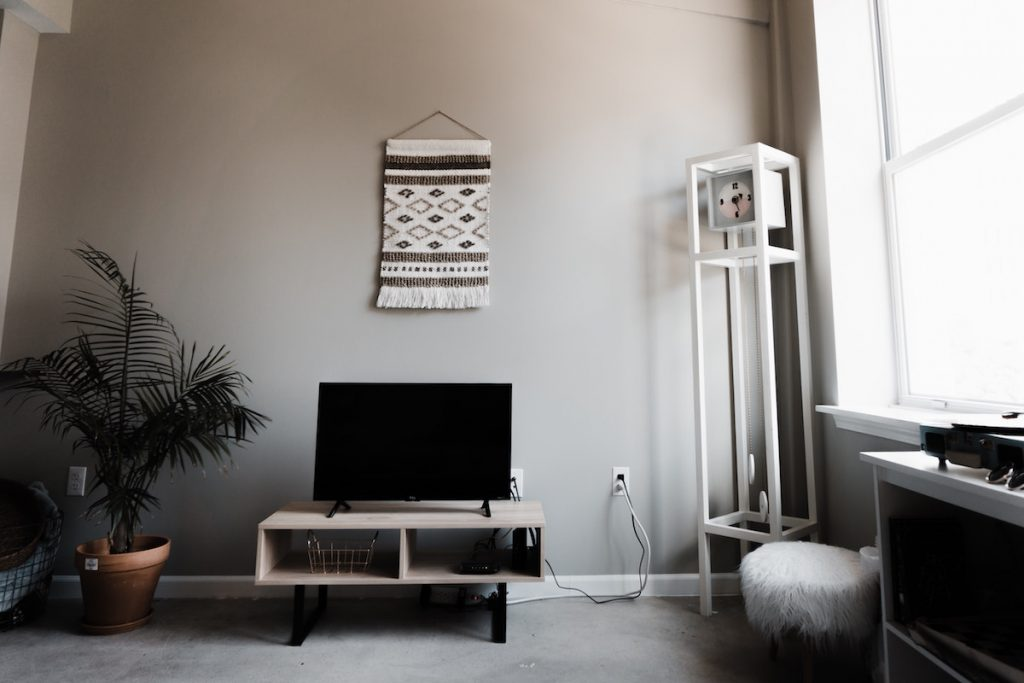 image of a modern TV room with a woven tapestry as wall decor
