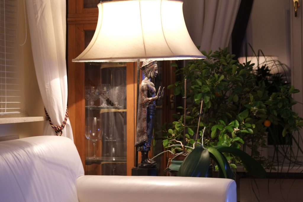 image of floor lamp next to chair for reading
