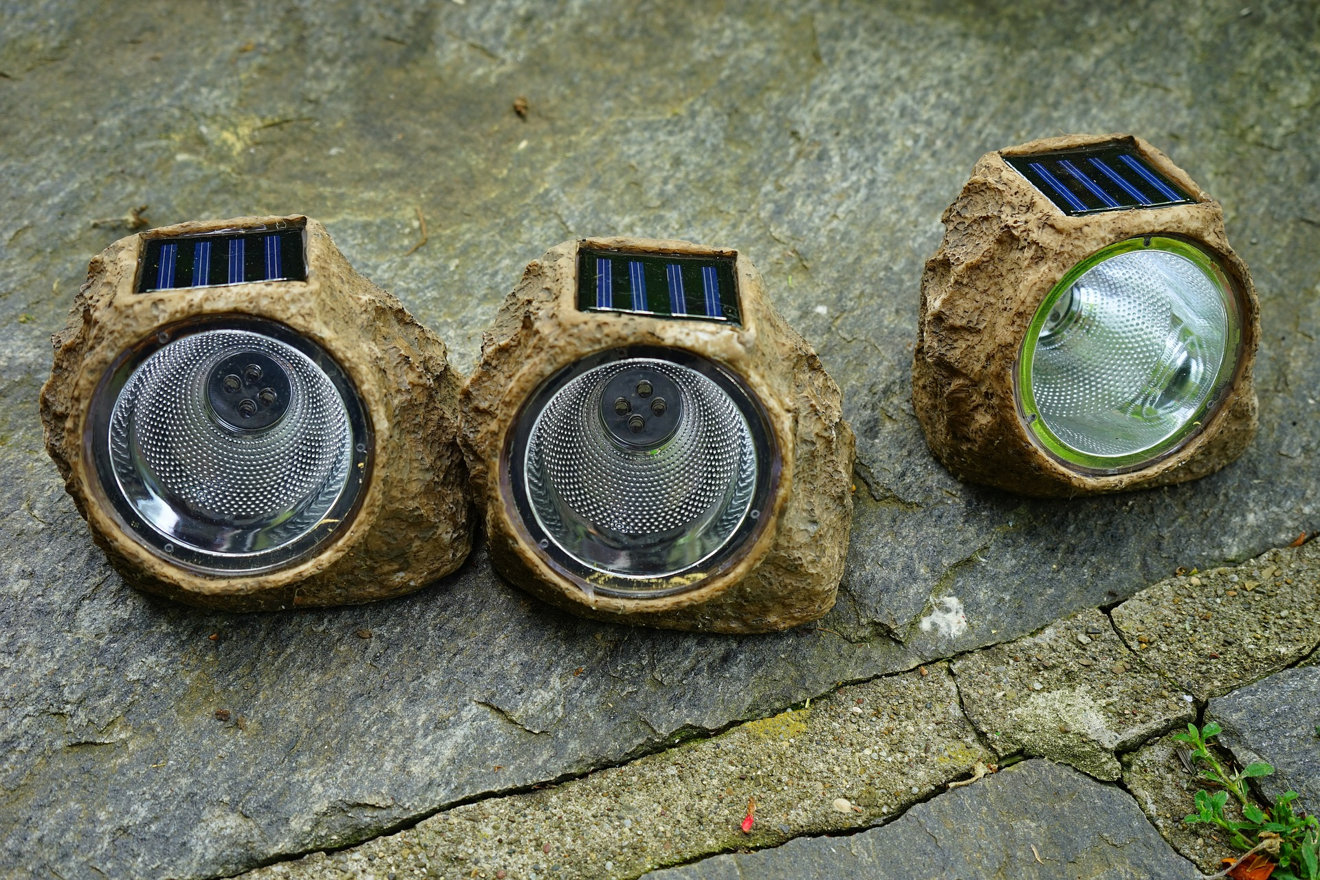 image of solar powered lights with an artificial rock housing