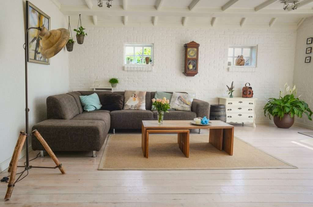 Image of a sunny living room with a wall clock to enhance the sound in the space