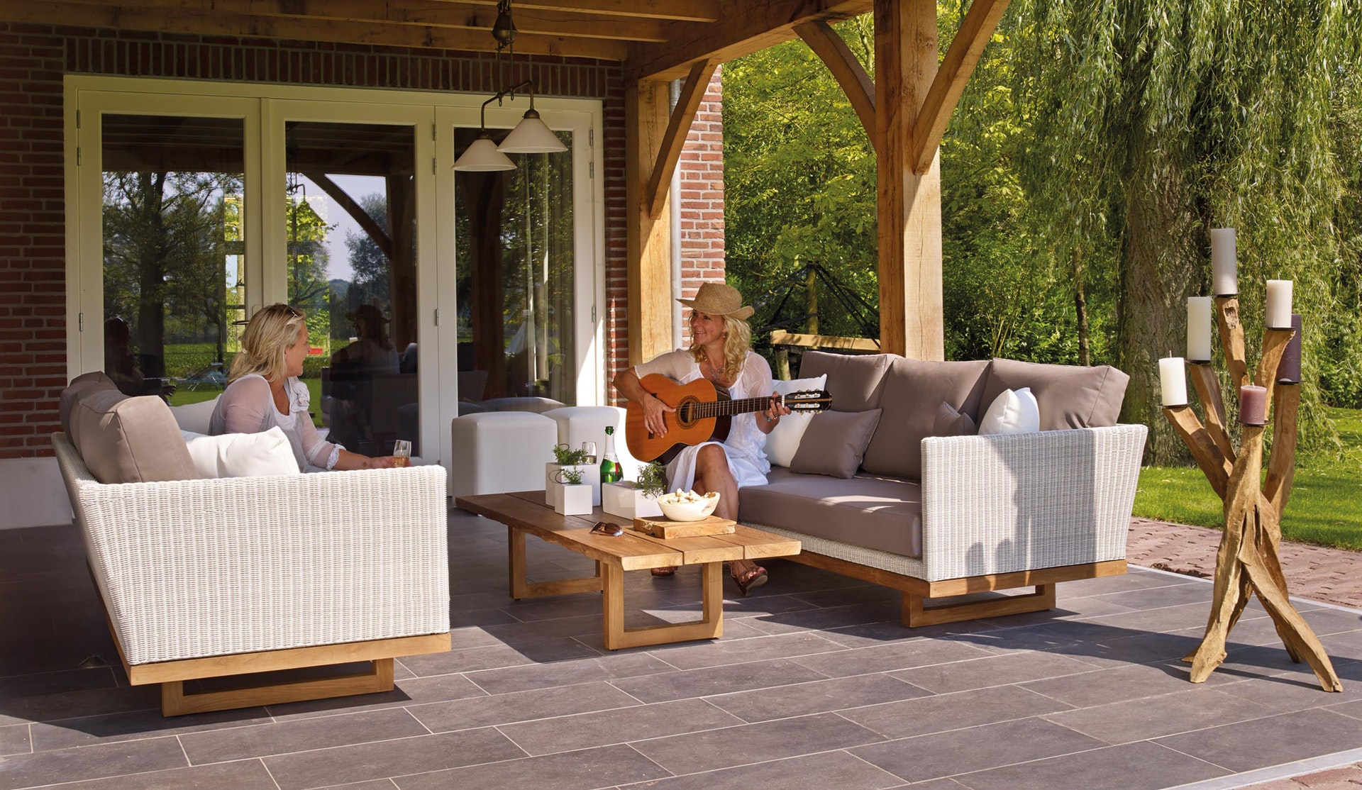 image of two ladies conversing in a beautiful outdoor living spaces patio