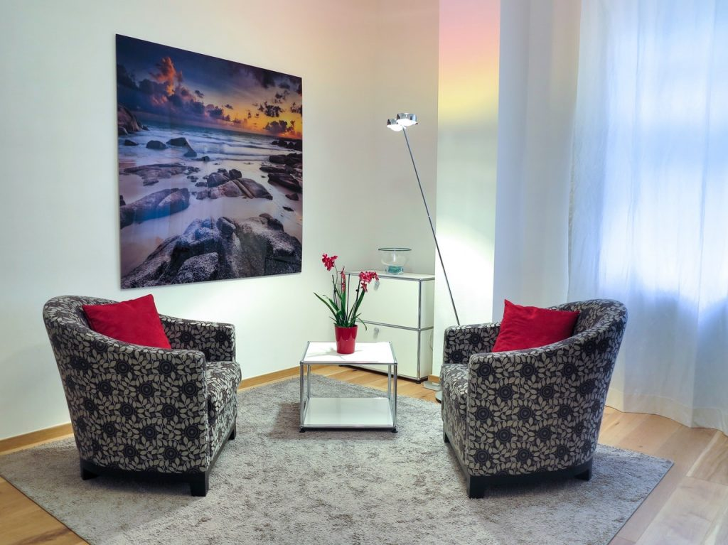 Image of two comfortable chairs facing each other with a photo to enhance wall decor.
