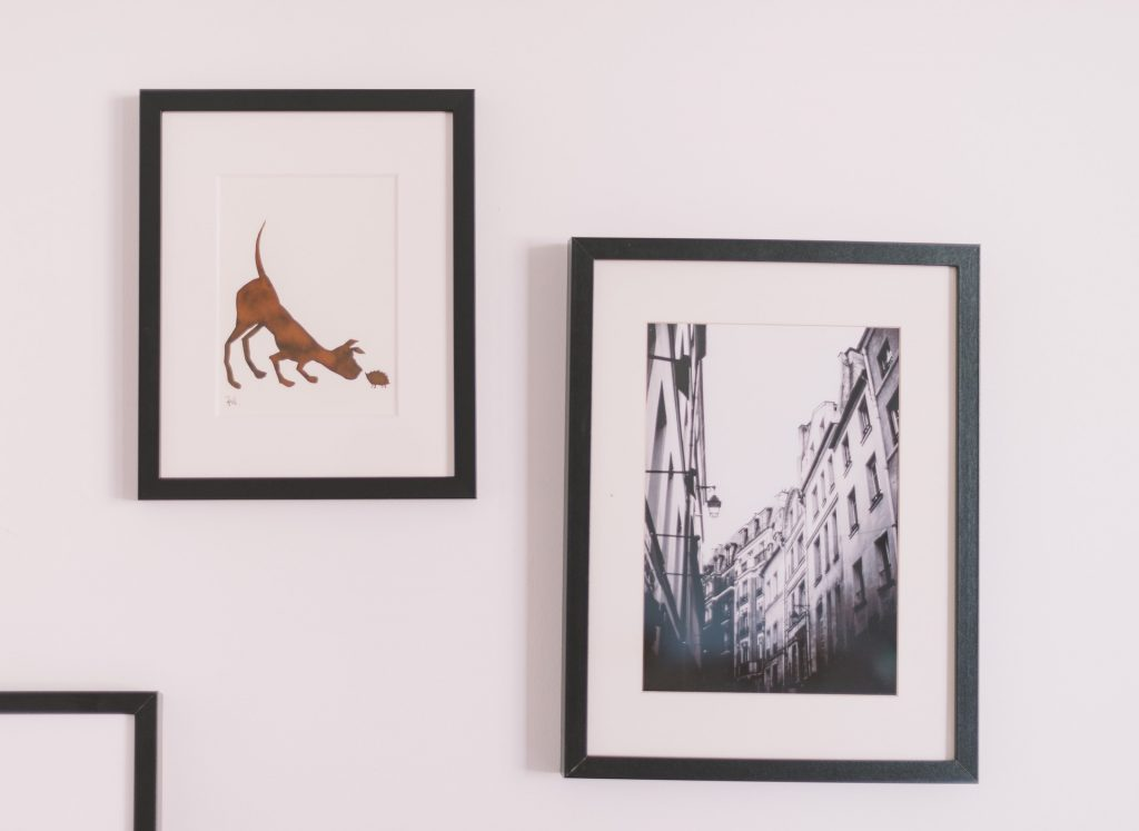 image of framed photos to illustrate ecclectic wall decor