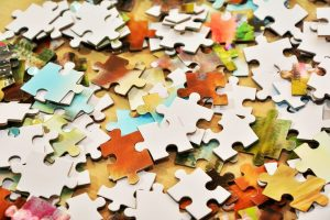 image of many colorful puzzle pieces in a small livingspace