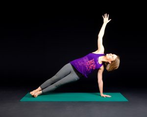 image of a lady in a yoga pose