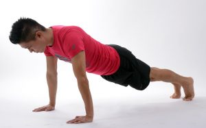 image of a young man in exercise cloths doing a pushup